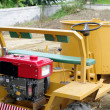 Yellow soil industrial tractor — Stock Photo