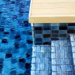 Blue swimming pool tiles — Stock Photo