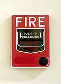 Red fire alarm on the wall — Stock Photo