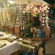 Craftman working at night market, night bazar — Stock Photo #34684585