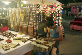 Craftman working at night market, night bazar — Stock Photo