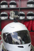 Go cart and racing sport helmet with camera — Stock Photo