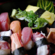 Stock Photo: Sushi set on black background