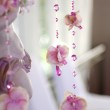 Flowers and beads curtain decorative for wedding — Stock Photo #37521609