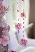 Flowers and beads curtain decorative for wedding — Stock Photo