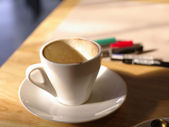 Empty coffee cup with working background — Stock Photo