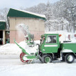 Green snow truck — Stock Photo