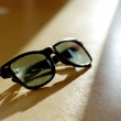 Sunglasses in sun light — Stock Photo #38859287