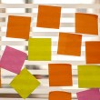 Stock Photo: Post it reminders in office