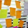 Post it reminders in office — Stock Photo