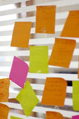 Post it reminders stick in office — Stock Photo