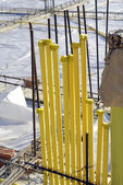 Yellow system pipe at construction site — Stock Photo