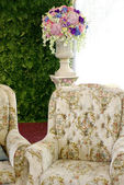 Classic sofa with flower — Photo