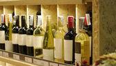 Wine bottles on shelf — Stock Photo