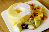 Sponge cake with fruits — Stock Photo