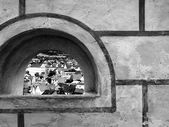 City view through stone openning window — Stock Photo