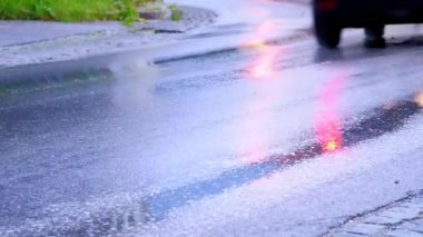 Car head light on wet street, abstract traffic — Stock Video