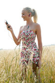 Young woman with mobile phone — Stock Photo