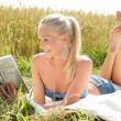 Young attractive woman reading a book — Stock Photo #34387661