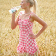 Young woman with bottle of water — Stock Photo