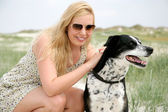 Young blonde woman with dog — Foto Stock
