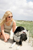 Young blonde woman with dog — Stock Photo