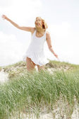 Young blonde woman in nature — Stock Photo