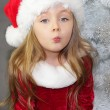 Girl in red dressed as Santa Claus with Christmas tree — Stock Photo #35257875