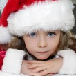 Girl in red dressed as Santa Claus with Christmas tree — Stock Photo #35257901