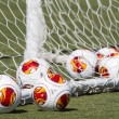 Europa League balls in net during Paok training — Stock Photo #33530249
