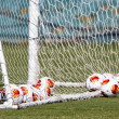 Europa League balls in net during Paok training — Stock Photo #33530281