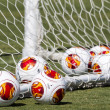 Europa League balls in net during Paok training — Stock Photo #33530467