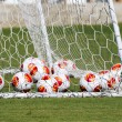 Europa League balls in net during Paok training — Stock Photo #33530537