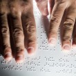 Blind reading text in braille language — Stock Photo #35923293
