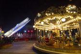 Luna park carousel in a public outdoor area — Photo