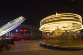 Luna park carousel in a public outdoor area — Stock Photo