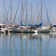 Stock Photo: Reflection in seof yacht masts
