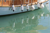 Picture presents a reflection of boats on sea — Stock Photo