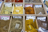 Various spices all over the world with greek names and prices — Stock Photo