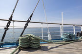 Thick ropes on a wooden sailing ship floor — Stock Photo
