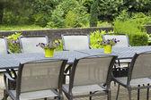 Patio furniture in a beautiful garden, close up. — Stockfoto