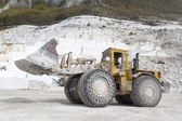 A loader in marble quarry — Stock Photo