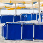 Sunchairs and umbrellas on beach bar — Stock Photo #47406953