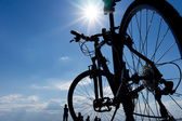 Silhouette of a bicycle against blue sky — Stock Photo