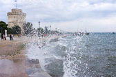 Gushing surf of a wave smashing against seaport at Thessaloniki, — Stock Photo