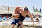 Two male athletes wrestle on sand during the First World Champio — Stockfoto