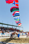 Two male athletes wrestle on sand during the First World Champio — Foto Stock