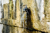 Old rusty water tap in village — Stock Photo