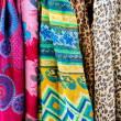 Colorful scarves at a market in Italy. Colors of textiles. — Stock Photo