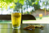 Glass of beer on wooden table — Stock Photo